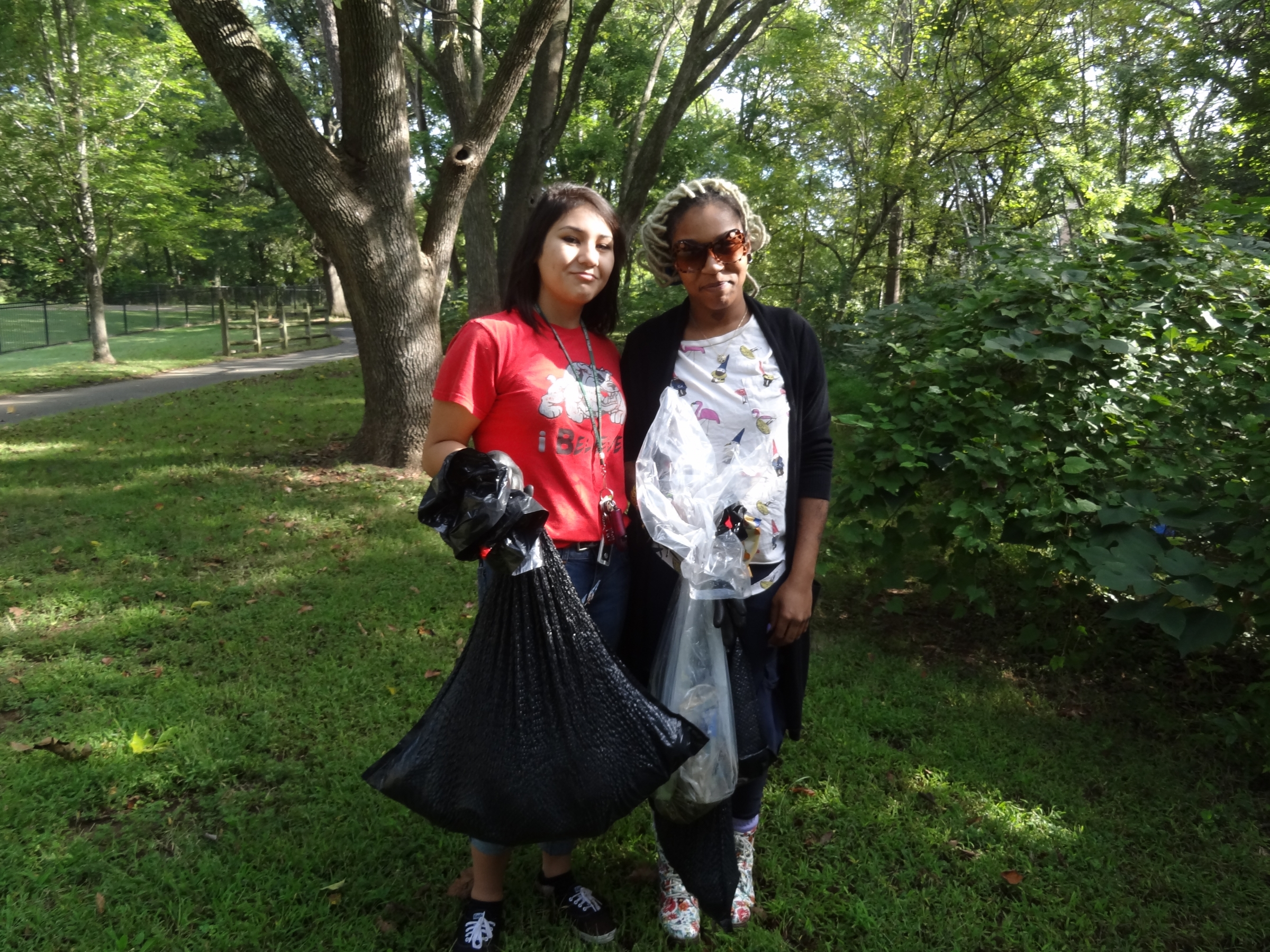 Dania Asaad, (left) and Shaneka Moore clean up Irwin Creek at the Big Sweep 2014. Photo: Amber Veverka