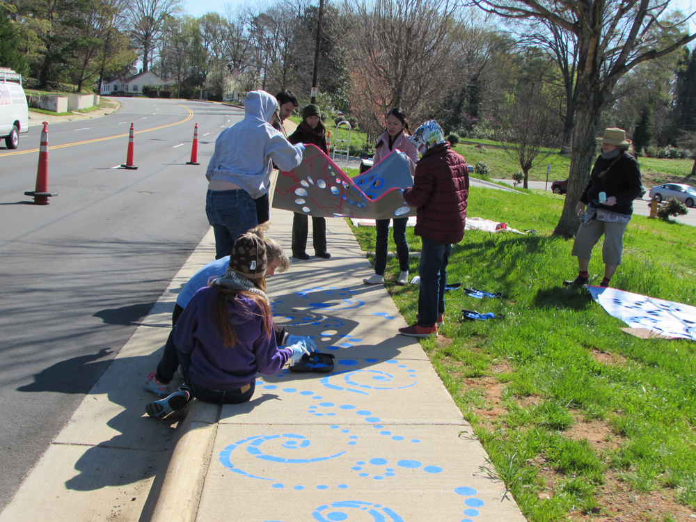 Volunteers help install artist Stacy Levy's Passage of Rain arts and education project in Revolution Park neighborhood the weekend of March 28-29. Photo: Charlotte-Mecklenburg Storm Water Services.